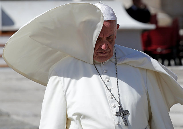 A gust of wind blows Pope Francis' mantle during the Wednesday general audience in Saint Peter's Square at the Vatican, September 20, 2017