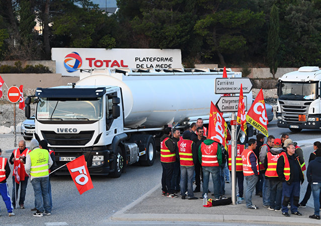 French truck drivers block access to the Total refinery to protest against the French labour law reform on September 25, 2017 in La Mede, near Marseille, southeastern France