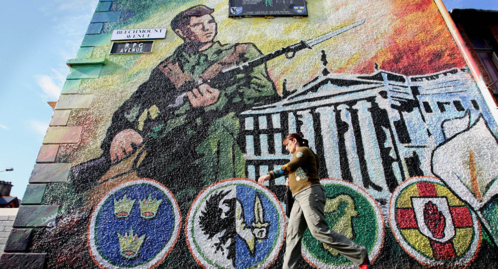 An Irish Republic Army (IRA) mural on a wall in west Belfast, Northern Ireland, Wednesday, Oct. 4, 2006.