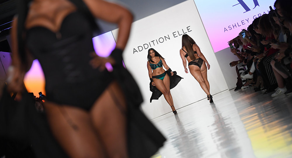 Model Ashley Graham (C) walks the runway for Addition Elle on September 11, 2017 during the New York Fashion Week in New York City