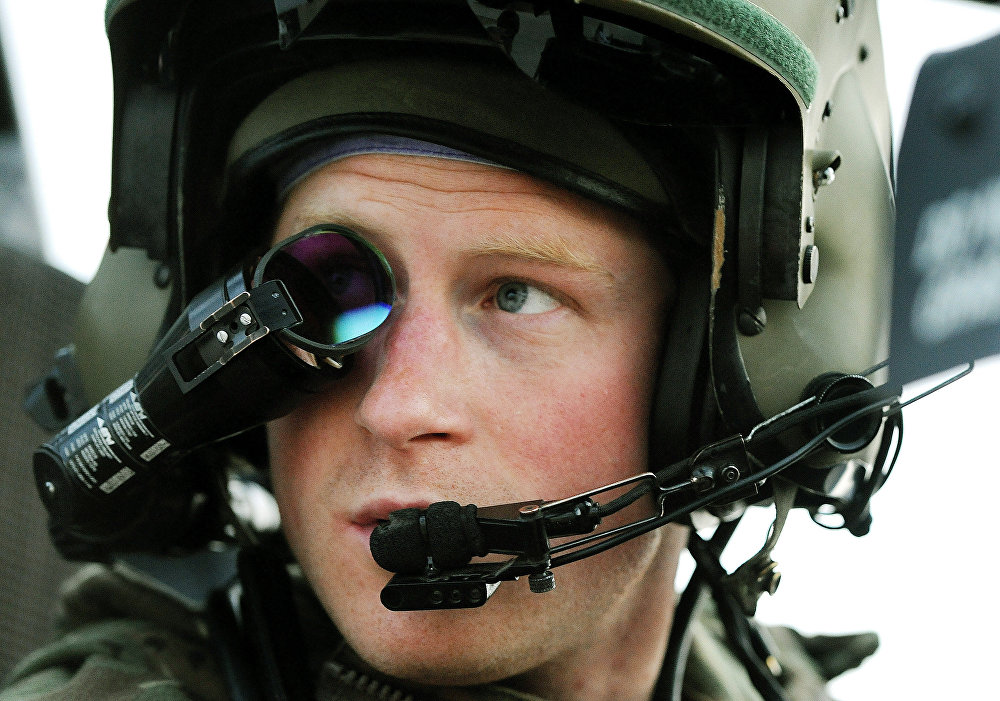 In this Dec. 12, 2012 file photo, Prince Harry wears his monocle gun sight as he sits in the front seat of his cockpit at the British controlled flight-line, in Camp Bastion, southern Afghanistan.