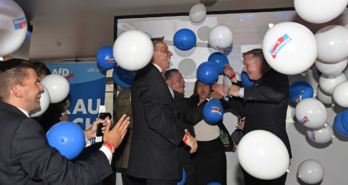 AfD board members celebrate with baloons during the election party of the nationalist 'Alternative for Germany', AfD, in Berlin, Germany, Sunday, Sept. 24, 2017, after the polling stations for the German parliament elections had been closed