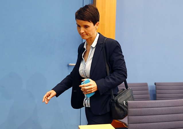 Frauke Petry, chairwoman of the anti-immigration party Alternative fuer Deutschland (AfD) leaves a news conference in Berlin, Germany