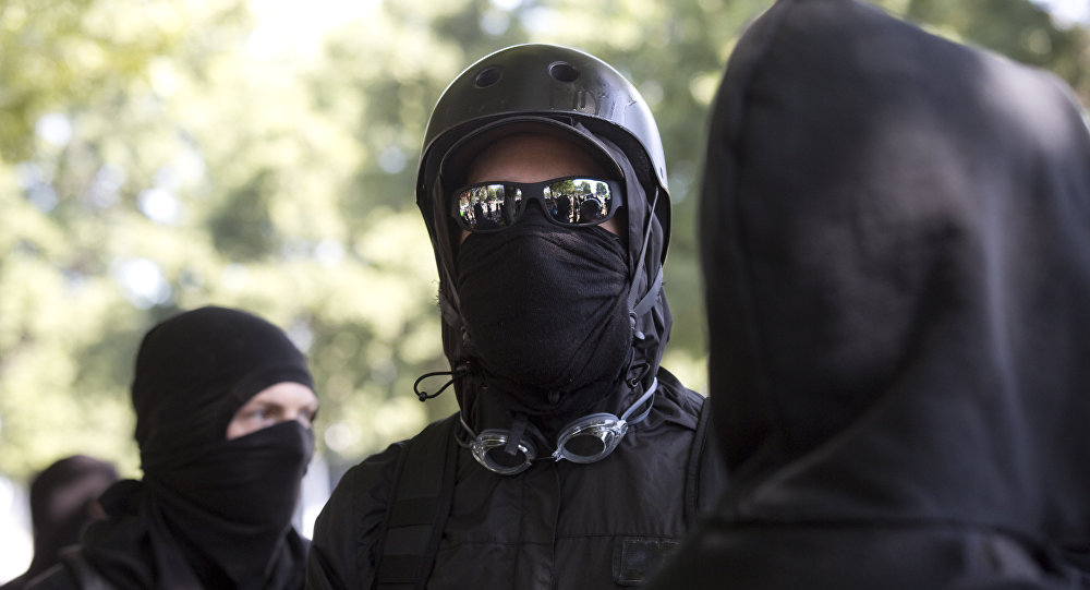 Antifa protesters wear bandanas over their face during a protest to oppose the right wing group The Patriot Prayer Movement, that was having a rally in downtown Portland, Oregon on September 10, 2017.