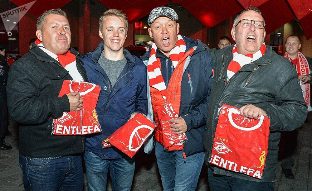 Fans get commemorative T-shirts ahead of the UEFA Champions League group stage match Spartak Russia vs. Liverpool England