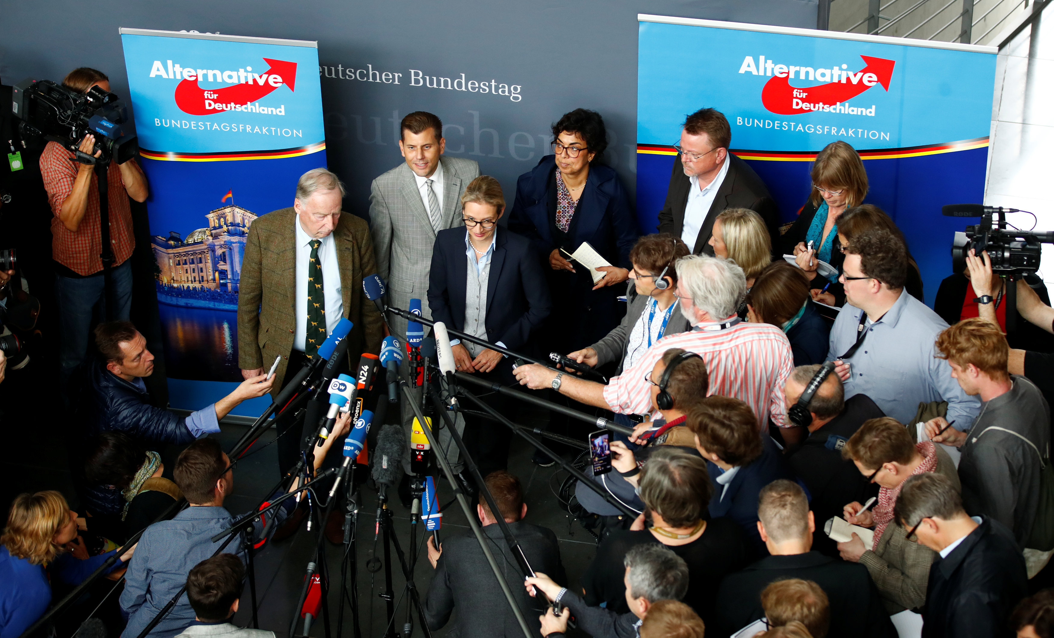 Anti-immigration party Alternative fuer Deutschland AfD top candidates Alice Weidel and Alexander Gauland address a news conference before a get together for their first parliamentary meeting in Berlin, Germany September 26, 2017