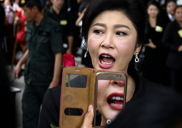 Ousted former Thai prime minister Yingluck Shinawatra greets supporters as she arrives at the Supreme Court in Bangkok, Thailand, July 21, 2017.
