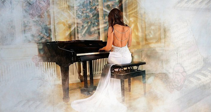 Woman plays a piano