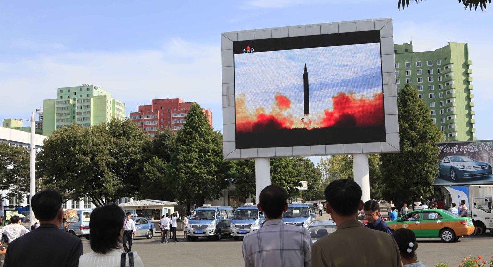 People watch a launching of a Hwasong-12 strategic ballistic rocket aired on a public TV screen at the Pyongyang Train Station in Pyongyang, North Korea, Saturday, Sept. 16, 2017