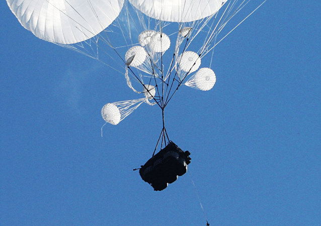 Airborne combat vehicles air dropped during the joint battalion tactical exercise of airborne troops from Russia, Belarus and Serbia at Rayevsky military base outside Novorossiysk