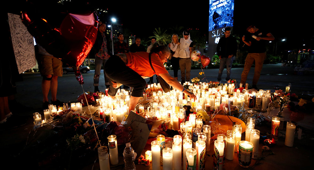 People gather at a vigil on the Las Vegas strip following a mass shooting at the Route 91 Harvest Country Music Festival in Las Vegas, Nevada, U.S., October 3, 2017
