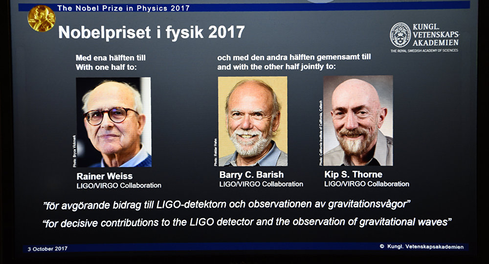 Laureates (L-R) Rainer Weiss, Barry C Barish and Kip S Thorne are pictured on a display during the announcement of the 2017 Nobel Prize winners in Physics on October 3, 2017, at the Royal Swedish Academy of Sciences in Stockholm