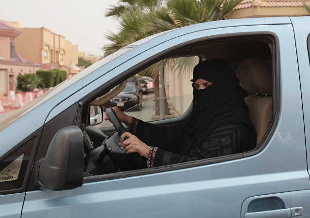 A woman drives a car in Riyadh, Saudi Arabia as part of a campaign to defy Saudi Arabia's ban on women driving (File)