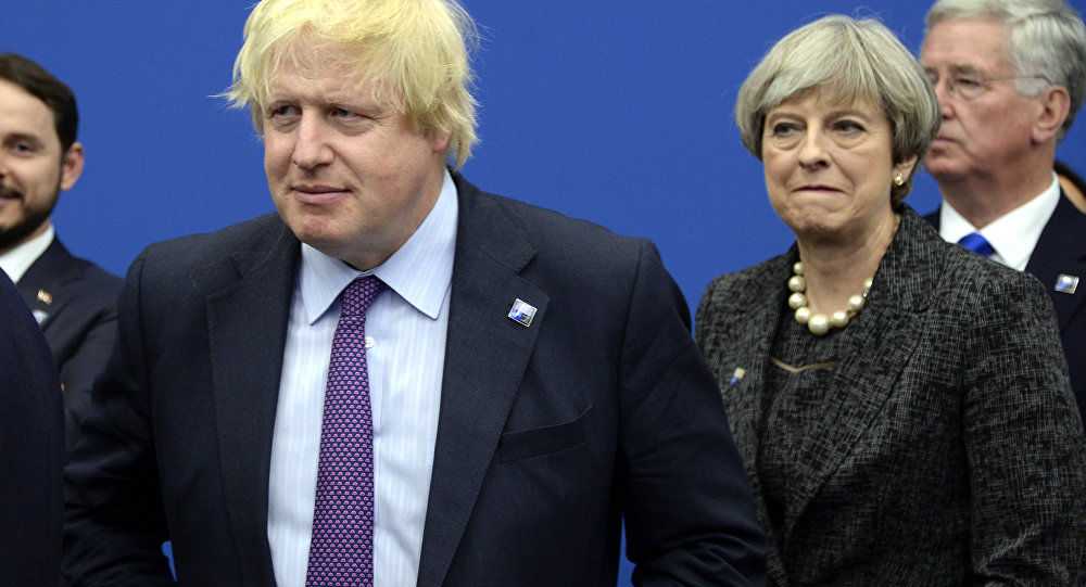 British Foreign Secretary Boris Johnson, left and Britain's Prime Minister Theresa May arrive for a meeting during the NATO summit of heads of state and government, at the NATO headquarters, in Brussels on Thursday, May 25, 2017.