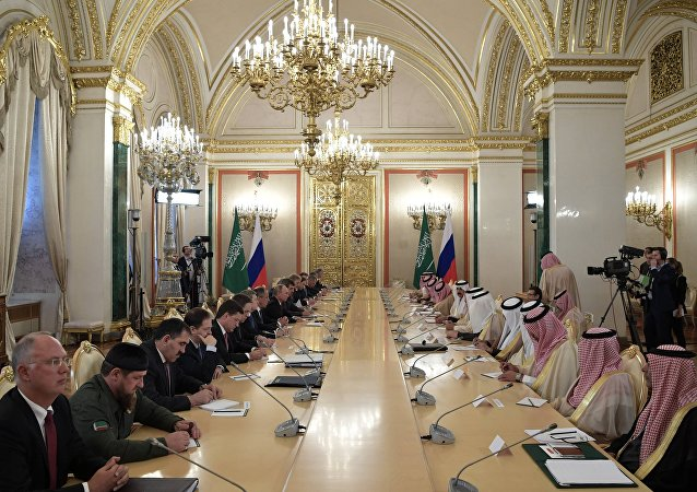 Russian President Vladimir Putin and King Salman bin Abdulaziz Al Saud of Saudi Arabia during Russian-Saudi negotiations