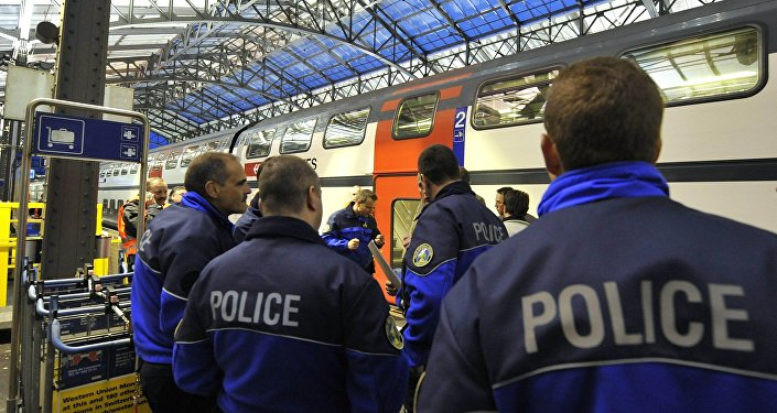 (File) Policemen stand on a platform of Lausanne main station.
