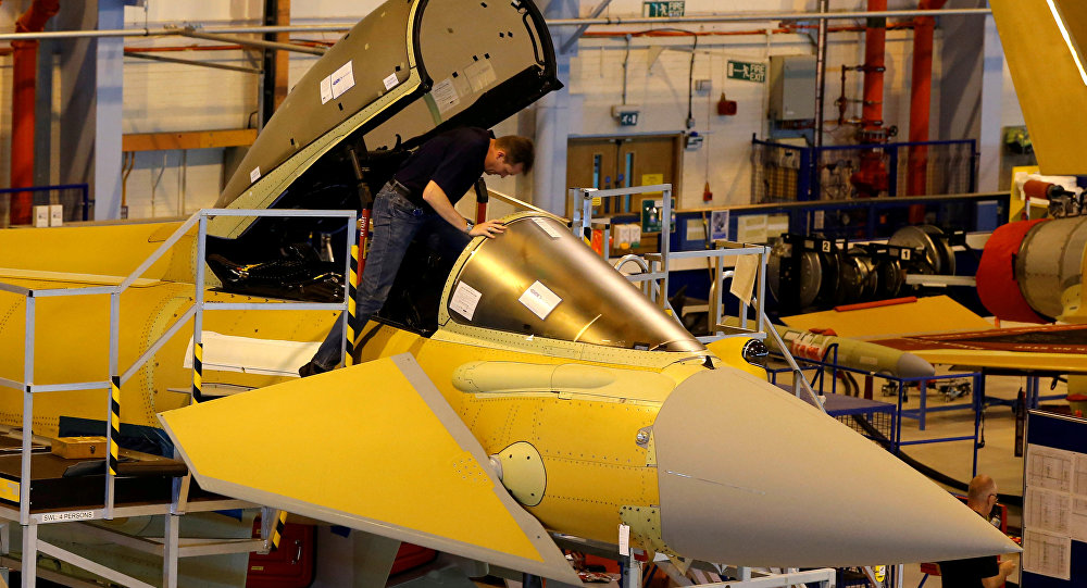 A member of staff works in the cockpit of an aircraft on the Eurofighter Typhoon production line at BAE systems Warton plant near Preston, Britain, September 7, 2012.