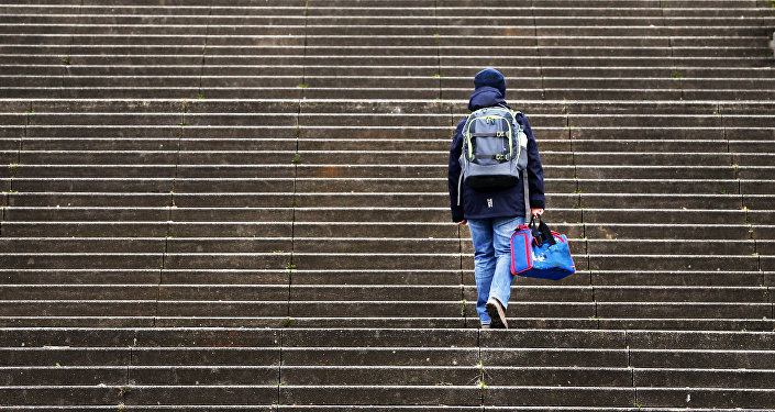 A boy walks up stairs on his way to school in Frankfurt, Germany, Tuesday, March 14, 2017