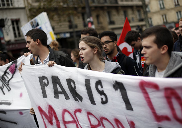 Demonstrators take the streets during a march to protest against President Emmanuel Macron's economic policies in Paris, France