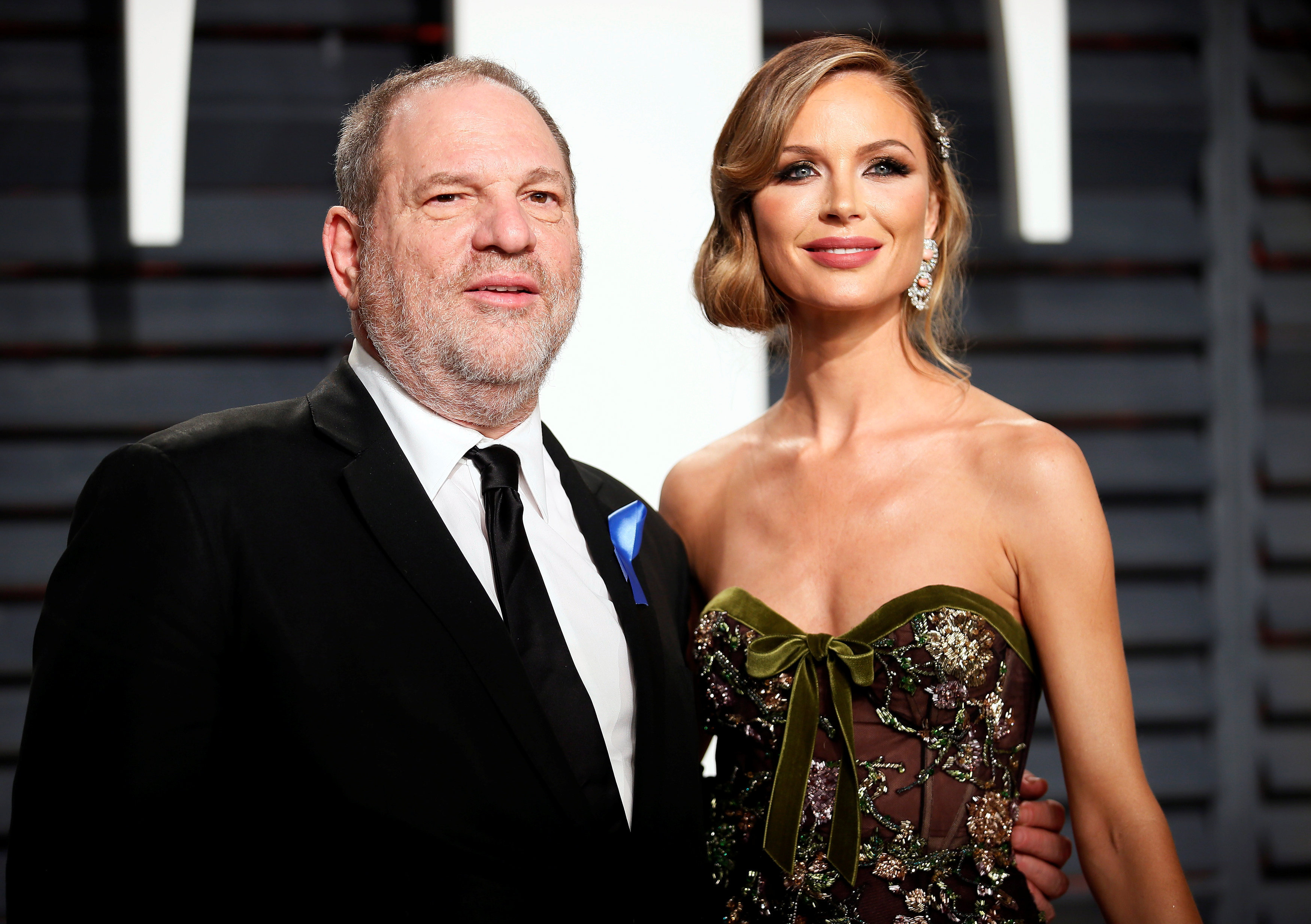 Producer Harvey Weinstein and his estranged fashion designer wife Georgina Chapman, who announced she has left him amid the scandal