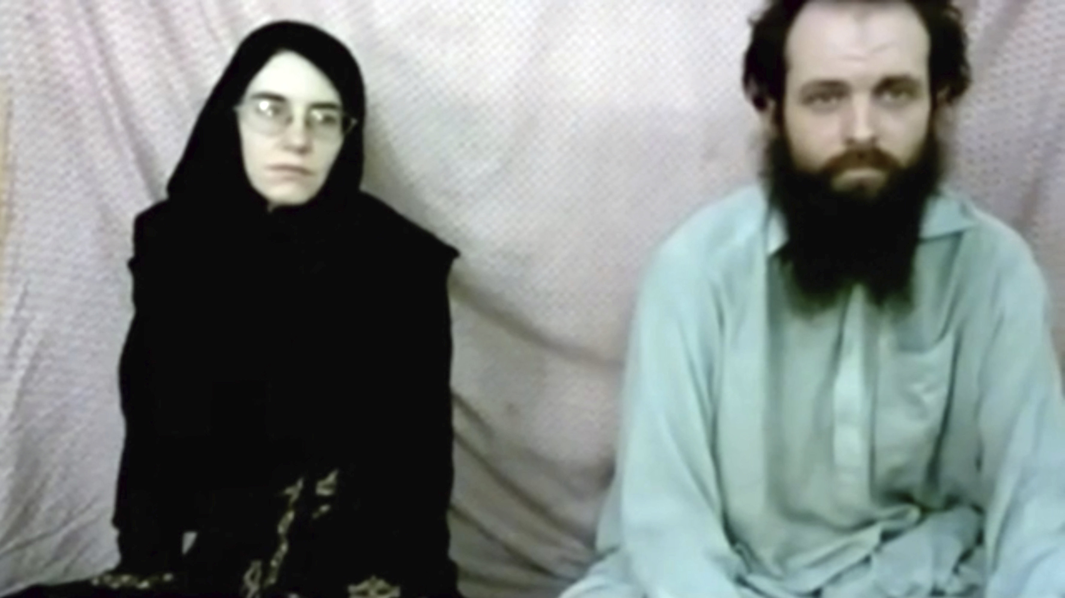 This still image made from a 2013 video released by the Coleman family shows Caitlan Coleman and her husband, Canadian Joshua Boyle in a militant video given to the family