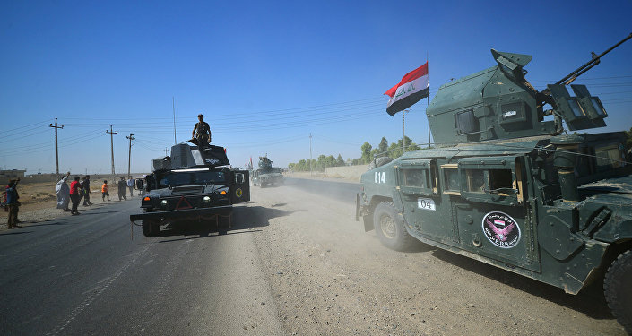 Members of Iraqi federal forces gather to continue to advance in military vehicles in Kirkuk, Iraq