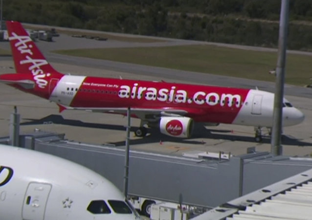 This Sunday, Oct. 15, 2017 image made from video shows an AirAsia plane at an airport in Perth, Australia.