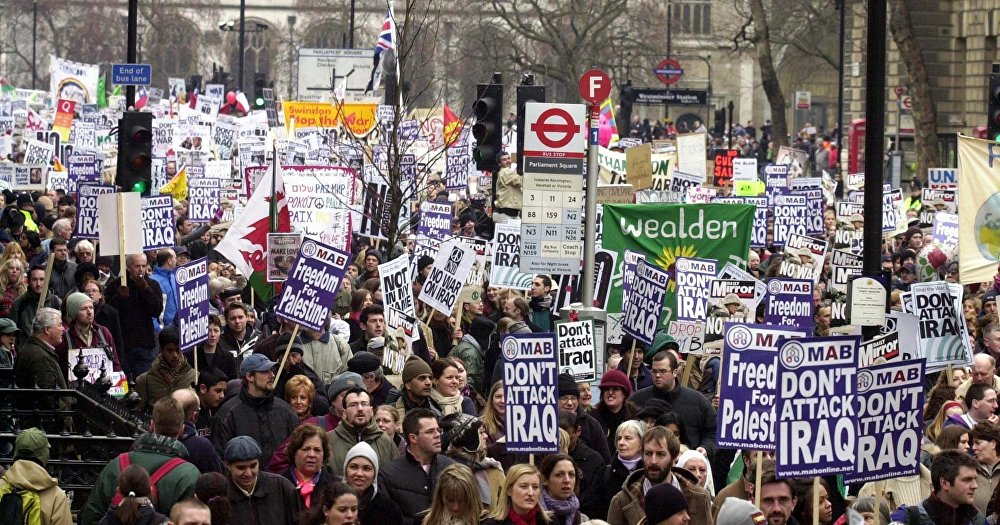 Demonstrators at the rally in London, 15 February 2003, as worldwide protests brought tens of thousands into the streets to show their opposition to a possible US-led war against Iraq.
