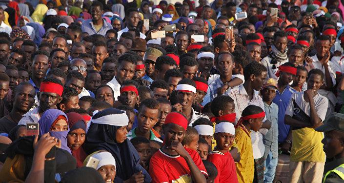 Angry protesters gather near the scene of Saturday's massive truck bomb attack, near the presidential palace, in Mogadishu, Somalia, Sunday, Oct. 15, 2017.