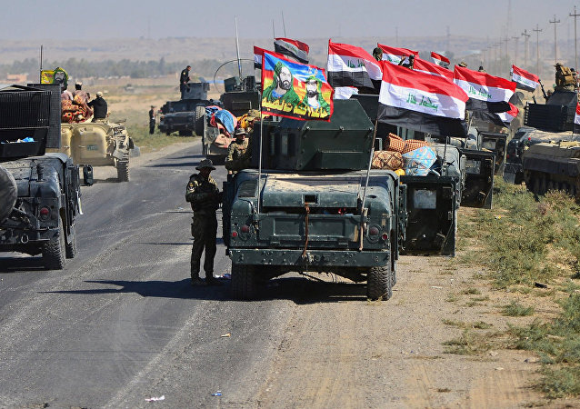 Members of Iraqi federal forces gather to continue to advance in military vehicles in Kirkuk, Iraq October 16, 2017.