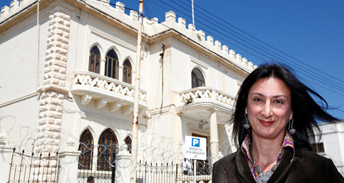 Maltese investigative journalist Daphne Caruana Galizia poses outside the Libyan Embassy in Valletta April 6, 2011. Investigative journalist Caruana Galizia was killed after a powerful bomb blew up a car killing her in Bidnija, Malta, in October 16, 2017.