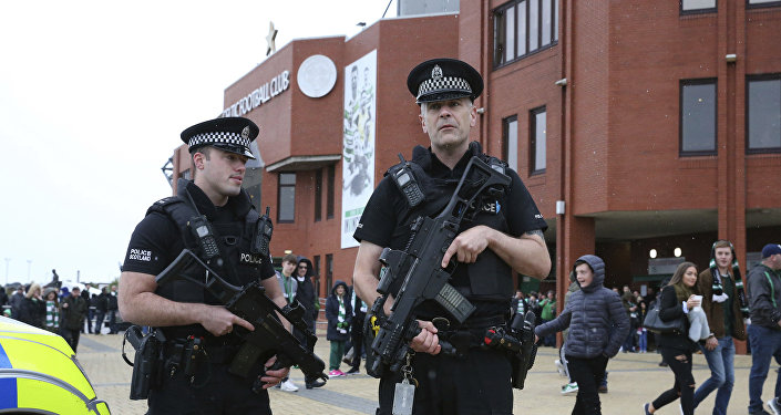 Armed police outside Celtic Park prior to the Scottish Premiership soccer match at Celtic Park in Glasgow, Scotland, Saturday Sept. 16, 2017