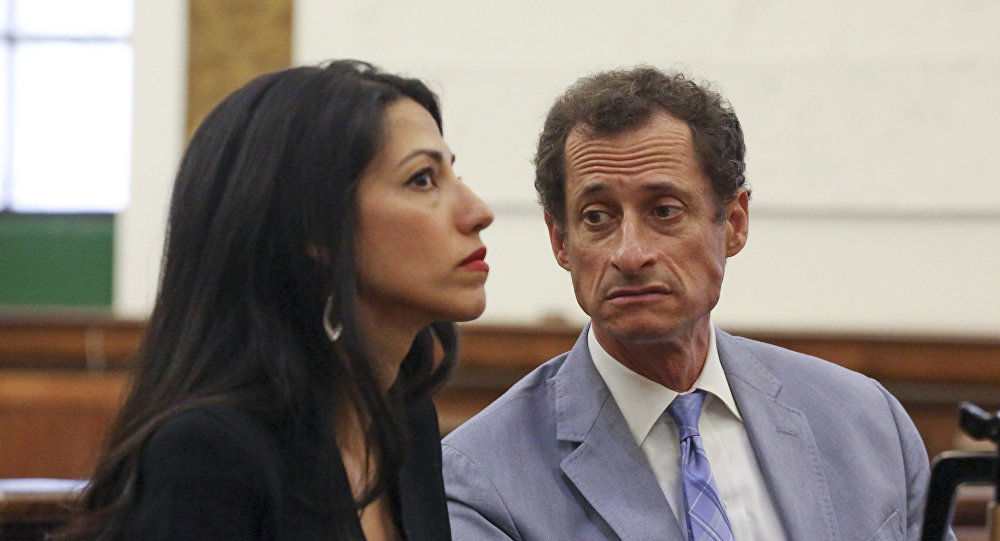Anthony Weiner, right, and Huma Abedin appear in court in New York on Wednesday, Sept. 13, 2017