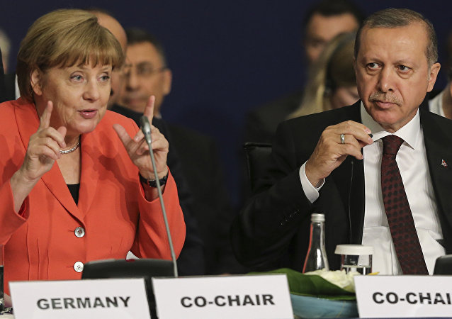 German Chancellor Angela Merkel, left, talks as Turkey's President Recep Tayyip Erdogan listens during a roundtable meeting on Political Leadership to Prevent and End Conflicts at the World Humanitarian Summit in Istanbul, Monday, May 23, 2016