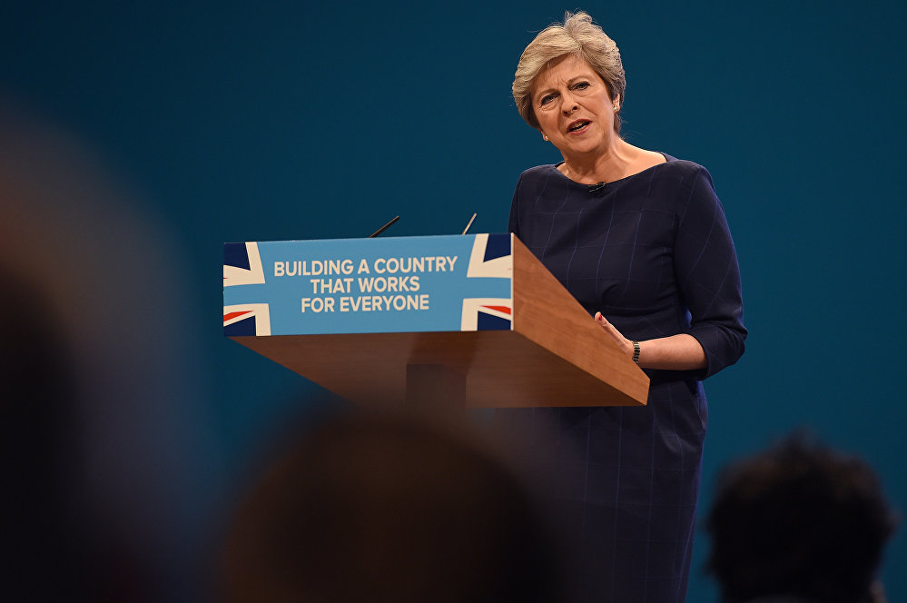 Britain's Prime Minister Theresa May delivers her speech on the final day of the Conservative Party annual conference at the Manchester Central Convention Centre in Manchester, northwest England.