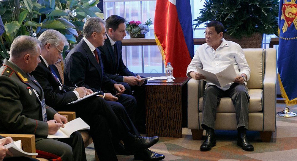 Russian Defense Minster Sergei Shoigu, third left, during a meeting with President of the Philippines Rodrigo Duterte, right, in the Philippines