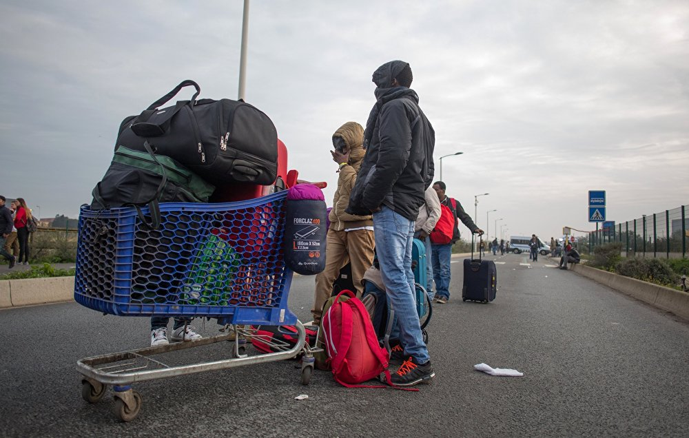 Refugees at a special center for the relocation of migrants (Centres d'Accueil at d'Orientation) near a refugee camp in Calais, France.
