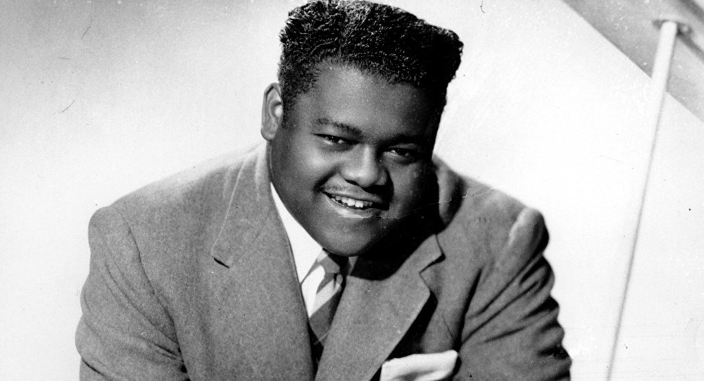 This is a 1956 photograph of singer, composer and pianist Fats Domino.