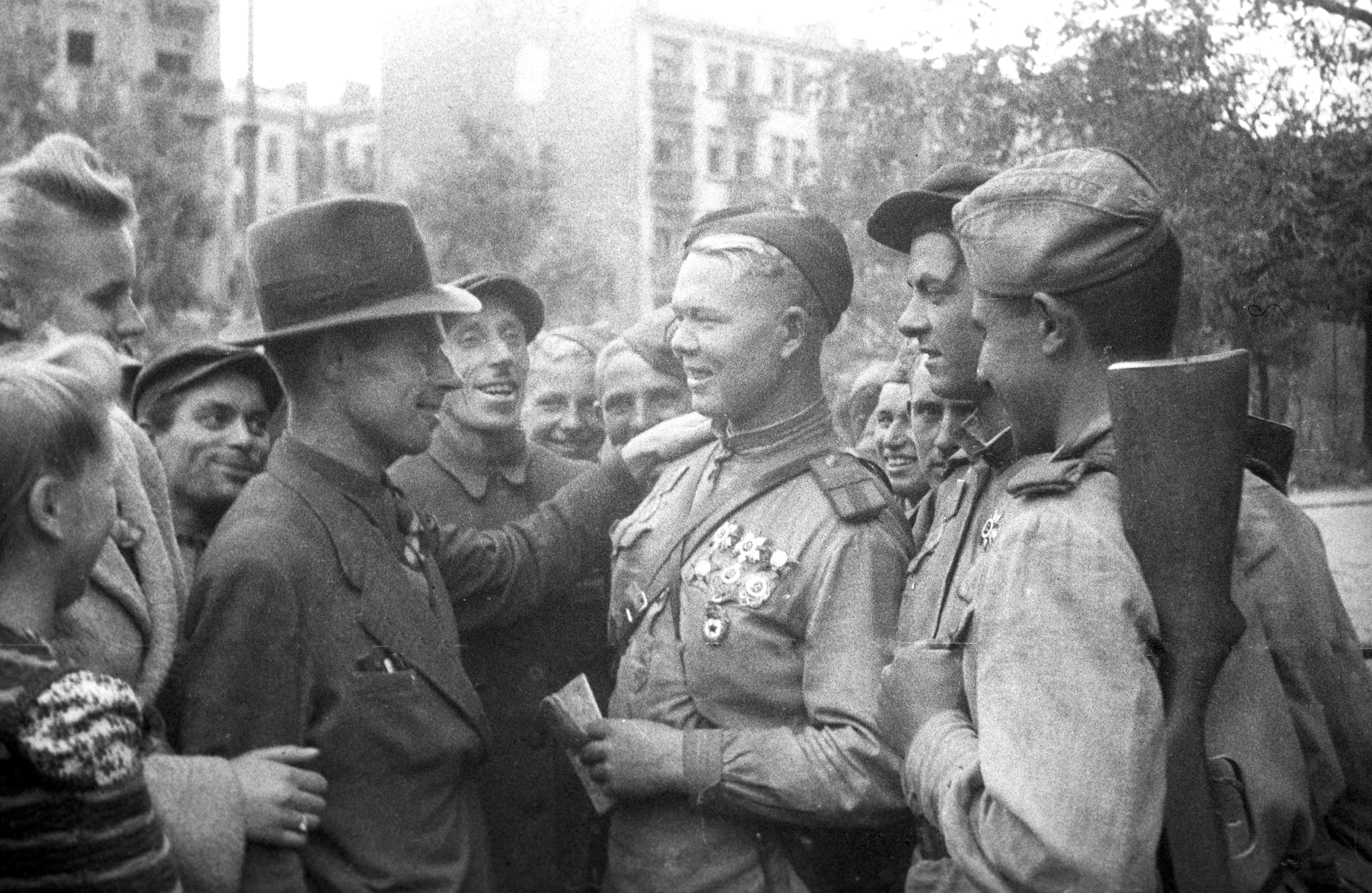 Local residents and Soviet fighters, Lublin. Poland. July 1944. The Great Patriotic War of 1941-1945