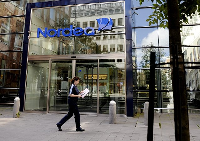 People walk by Nordea Bank headquarters in central Stockholm