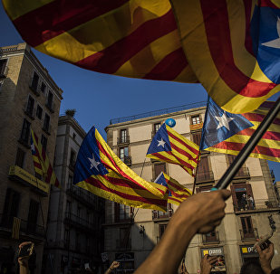People wave independence flags just after the speech of Catalan regional president Carles Puigdemont in Barcelona, Spain, Thursday, Oct. 26, 2017.