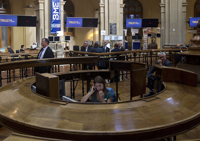 A worker speaks on a cell phone at the Stock Exchange in Madrid