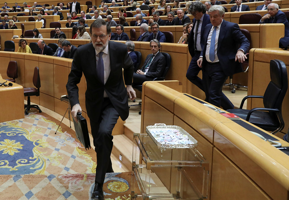 Spain's Prime Minister Mariano Rajoy leaves his seat during a debate at the upper house Senate in Madrid, Spain, October 27, 2017