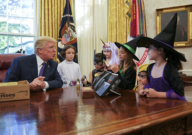 President Donald Trump meets with children dressed in their Halloween costumes in the Oval Office of the White House, Friday, Oct. 27, 2017.