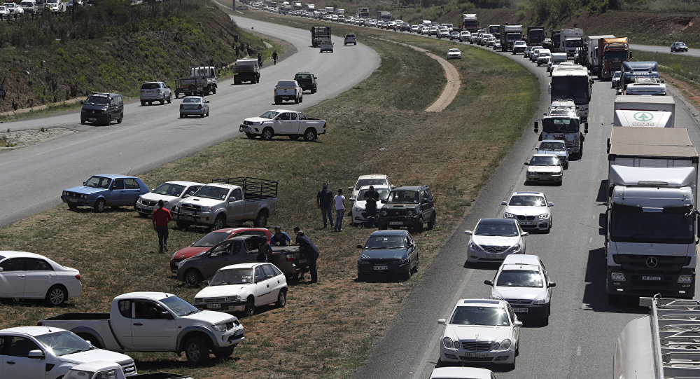 Vehicles blockade a freeway between Johannesburg and Vereeniging, South Africa, in protest against the recent murder of farmers