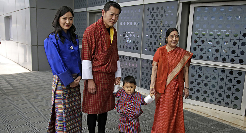 Indian External Affairs Minister Sushma Swaraj, right, poses with Bhutan's King Jigme Khesar Namgyal Wangchuck, second left, Queen Jetsun Pema, left and their son prince Jigme Namgyel Wangchuck after receiving them at the airport in New Delhi, India
