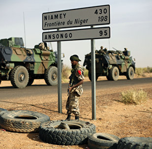 This Feb. 6, 2013, file photo shows French armoured vehicles heading towards the Niger border before making a left turn north in Gao, northern Mali.