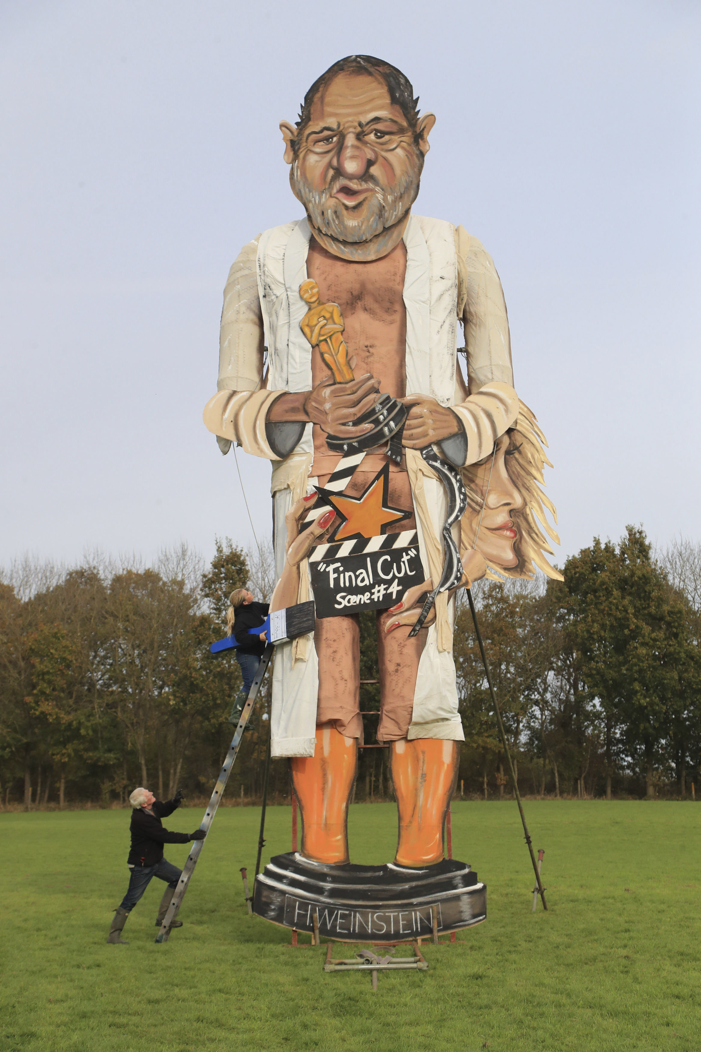 Artists Frank Shepherd and Andrea Deans put the finishing touches to the Edenbridge Bonfire Society effigy, which has been unveiled as Harvey Weinstein, for Bonfire Night in Edenbridge, England, Wednesday, Nov. 1, 2017