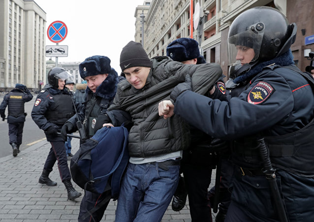Police officers detain a man in the centre of Moscow, Russia November 5, 2017