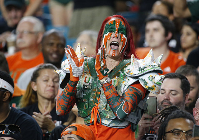 A Miami fan cheers before the start of an NCAA College football game between Miami and Virginia Tech, Saturday, Nov. 4, 2017 in Miami Gardens, Fla.